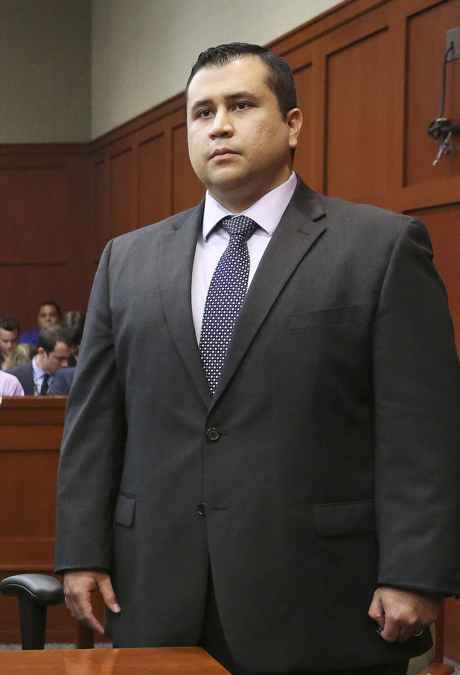 George Zimmerman listens as the verdict is announced in Seminole Circuit Court in Sanford, Fla. on Saturday, July 13, 2013. Jurors found Zimmerman not guilty of second-degree murder in the fatal shooting of 17-year-old Trayvon Martin in Sanford, Fla. The six-member, all-woman jury deliberated for more than 15 hours over two days before reaching their decision Saturday night. (AP Photo/Joe Burbank, Pool) ORG XMIT: FLJR406