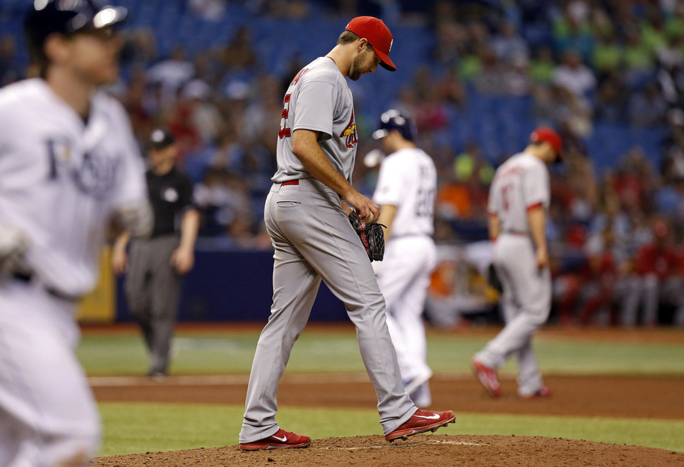 Photo - St. Louis Cardinals starting pitcher Michael Wacha reacts after walking Tampa Bay Rays' Ryan Hanigan during the fourth inning of a baseball game Wednesday, June 11, 2014, in St. Petersburg, Fla. (AP Photo/Mike Carlson)