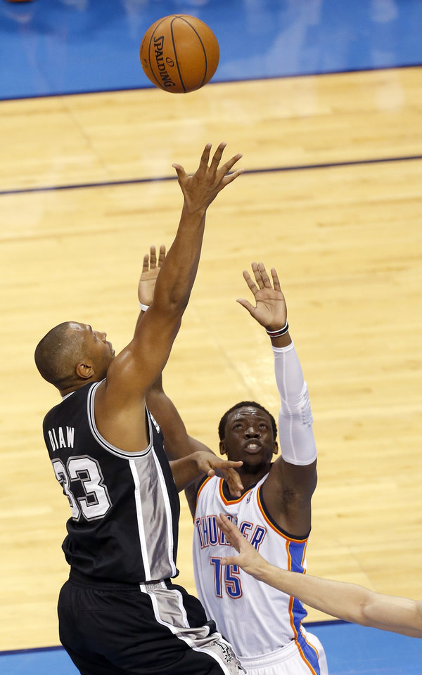 Photo - San Antonio's Boris Diaw (33) shots over Oklahoma City's Reggie Jackson (15) during Game 6 of the Western Conference Finals in the NBA playoffs between the Oklahoma City Thunder and the San Antonio Spurs at Chesapeake Energy Arena in Oklahoma City, Saturday, May 31, 2014. Photo by Nate Billings, The Oklahoman
