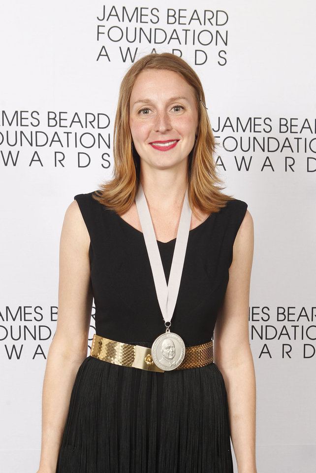 Photo -   Christina Tosi, of Momofuku Milk Bar in New York, poses with her Rising Star Chef of the Year medal during the James Beard Foundation Awards, Monday, May 7, 2012, in New York. (AP Photo/Jason DeCrow)
