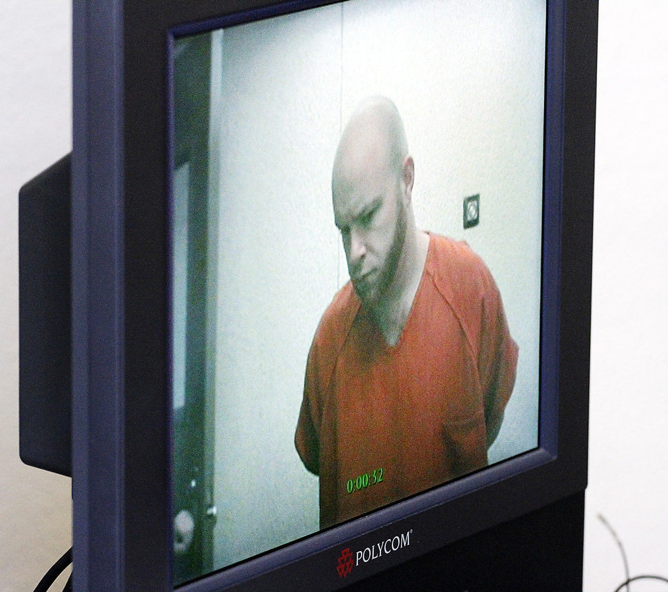 Photo - Justin Adams appears before Judge Russell Hall during his video arraignment at the Oklahoma County Courthouse in Oklahoma City, Monday, January 30, 2012. Adams is charged with the death of his wife, Jaymie Adams and her unborn child. Photo By Steve Gooch, The Oklahoman
