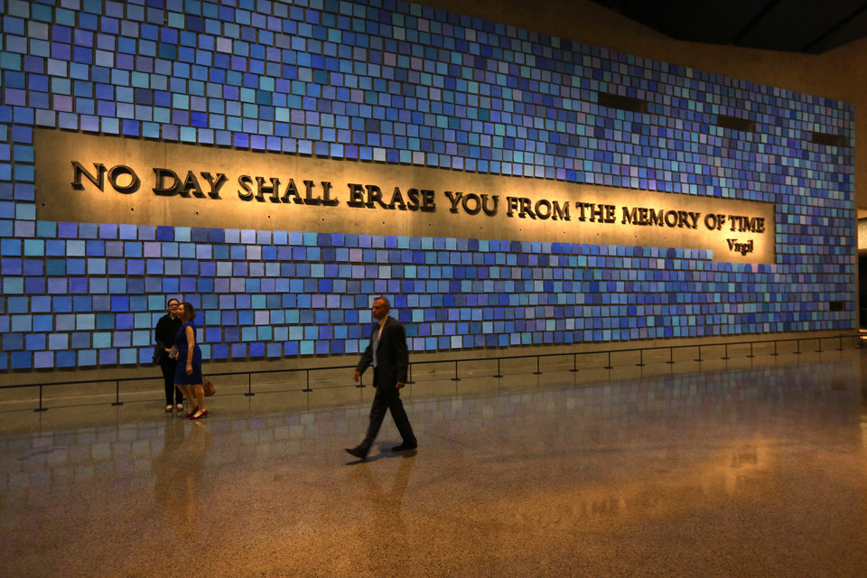 Photo -  A quote from Virgil fills a wall of the museum prior to the May 15 dedication ceremony at the National September 11 Memorial Museum in New York. (AP Photo/The Star-Ledger, John Munson, Pool)   John Munson -