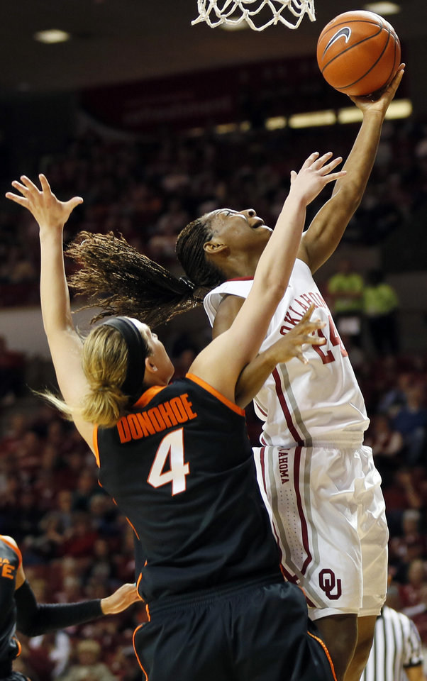 Photo - Oklahoma's Sharane Campbell (24) tries to score past Oklahoma State's Liz Donohoe (4) in the second half during a women's Bedlam college basketball game between the Oklahoma State University Cowgirls (OSU) and the University of Oklahoma Sooners (OU) at Lloyd Noble Center in Norman, Okla., Saturday, Feb. 1, 2014. OU won, 81-74. Photo by Nate Billings, The Oklahoman