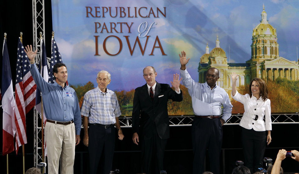 Photo -   Republican presidential candidates, from left, former Pennsylvania Senator Rick Santorum, U.S. Rep. Ron Paul, R-Texas, U.S. Rep. Thaddeus McCotter, R-Mich., former CEO of Godfather's Pizza Herman Cain, and U.S. Rep. Michele Bachmann, R-Texas, gather on stage before the Iowa Republican Party's Straw Poll, Saturday, Aug. 13, 2011, in Ames, Iowa. (AP Photo/Charlie Neibergall)