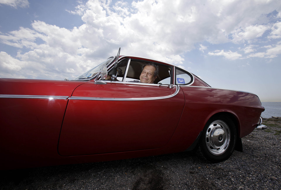 Photo -   Irv Gordon poses for a picture in his Volvo P1800 in Babylon, N.Y., Monday, July 2, 2012. Gordon's car already holds the world record for the highest recorded milage on a car and he is less than 40,000 miles away from passing three million miles on the Volvo. (AP Photo/Seth Wenig)