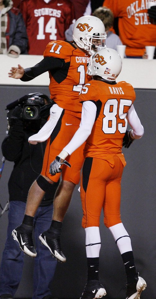 Zac Robinson celebrates his touchdown run with Damian Davis during the second half of the college football game between the University of Oklahoma Sooners (OU) and Oklahoma State University Cowboys (OSU) at Boone Pickens Stadium on Saturday, Nov. 29, 2008, in Stillwater, Okla. STAFF PHOTO BY BRYAN TERRY