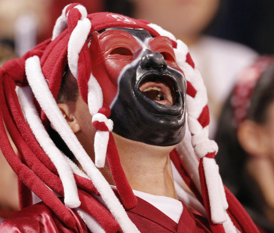 Photo - Greg Longacre, Wichita, Kansas, yells during the first half of the college football game between the University of Oklahoma (OU) Sooners and the University of Colorado Buffaloes at Gaylord Family-Oklahoma Memorial Stadium in Norman, Okla., Saturday, October 30, 2010.  Photo by Steve Sisney, The Oklahoman