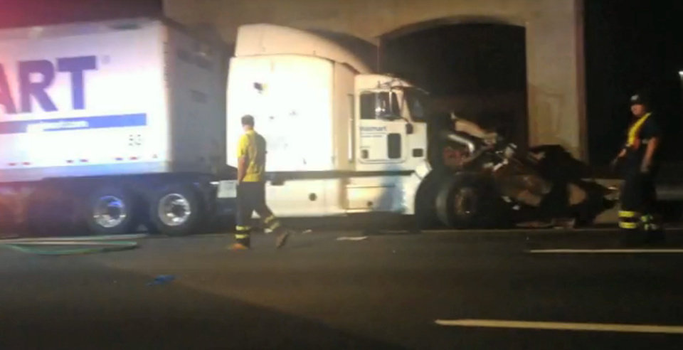Photo - In this image from video the Wal-Mart truck involved in the crash of the limousine bus carrying Tracy Morgan and six other people is seen early Saturday morning June 7, 2014 on the New Jersey Turnpike at the accident scene. Morgan remained hospitalized as state and federal officials continued their investigation of the six-vehicle crash on the New Jersey Turnpike that took the life of a Morgan friend and left two others seriously injured, authorities say. Wal-Mart President Bill Simon said in a statement a Wal-Mart truck was involved and that the company