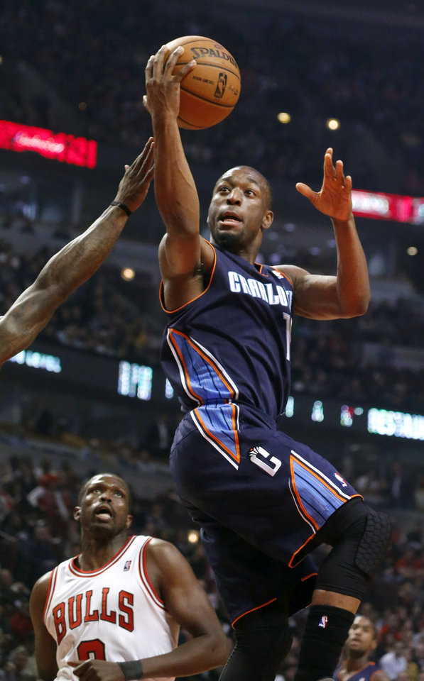 Charlotte Bobcats guard Kemba Walker shoots past Chicago Bulls forward Luol Deng during the first half of an NBA basketball game, Monday, Jan. 28, 2013, in Chicago. (AP Photo/Charles Rex Arbogast)