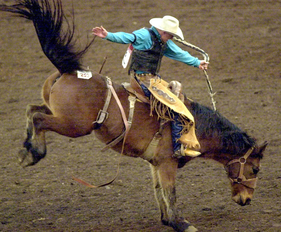 IFR: Cord McCoy, Tupelo, Okla., rides Saddle Bronc at the International Finals Rodeo at State Fair Arena on Friday, Jan. 18, 2002. Staff photo by Nate Billings.