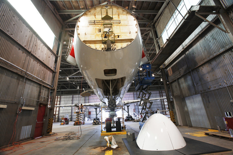 Photo - An aircraft undergoes maintenance at First Wave, in one of the hangars at the Oklahoma Spaceport in Burns Flat. Photo by David McDaniel, THE OKLAHOMAN