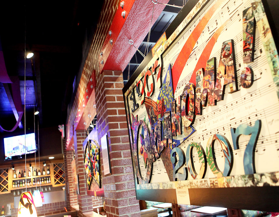 Photo - Collages hang inside the Hideaway Pizza on Northwest Expressway in Oklahoma City. Photo By John Clanton, The Oklahoman