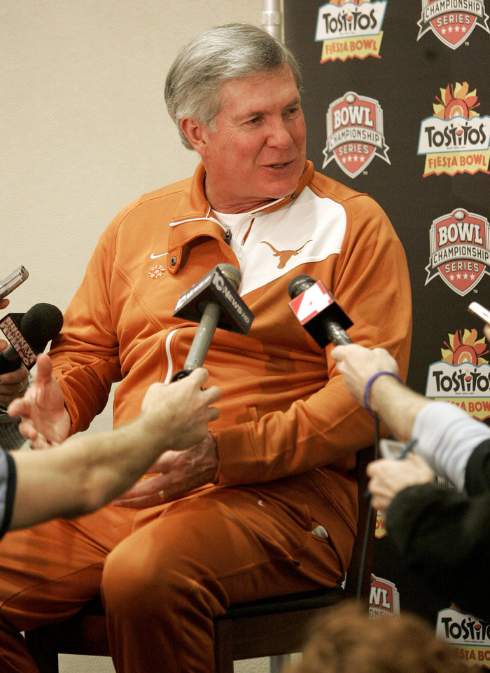 Photo - University of Texas head coach Mack Brown talks with the media during the Fiesta Bowl media day Friday, Jan. 2, 2009 in Scottsdale, Ariz.  Texas will face Ohio State in the Fiesta Bowl NCAA college football game, Monday, Jan. 5, 2009. (AP Photo/Matt York) ORG XMIT: AZMY103