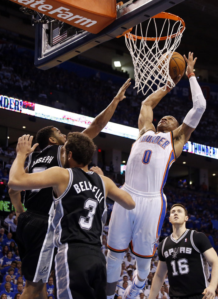 Photo - Oklahoma City's Russell Westbrook (0) goes up for a dunk as San Antonio's Marco Belinelli (3) and Cory Joseph (5) defend during Game 4 of the Western Conference Finals in the NBA playoffs between the Oklahoma City Thunder and the San Antonio Spurs at Chesapeake Energy Arena in Oklahoma City, Tuesday, May 27, 2014. Photo by Nate Billings, The Oklahoman