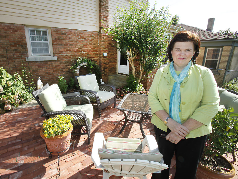 Rosemary Lewis on the patio at her home on NW 28th, Monday, July 16 , 2012. The Lewis' have spent years peeling off metal siding and working on their home bit by bit to bring it back to its 1930s glory. Photo By David McDaniel/The Oklahoman
