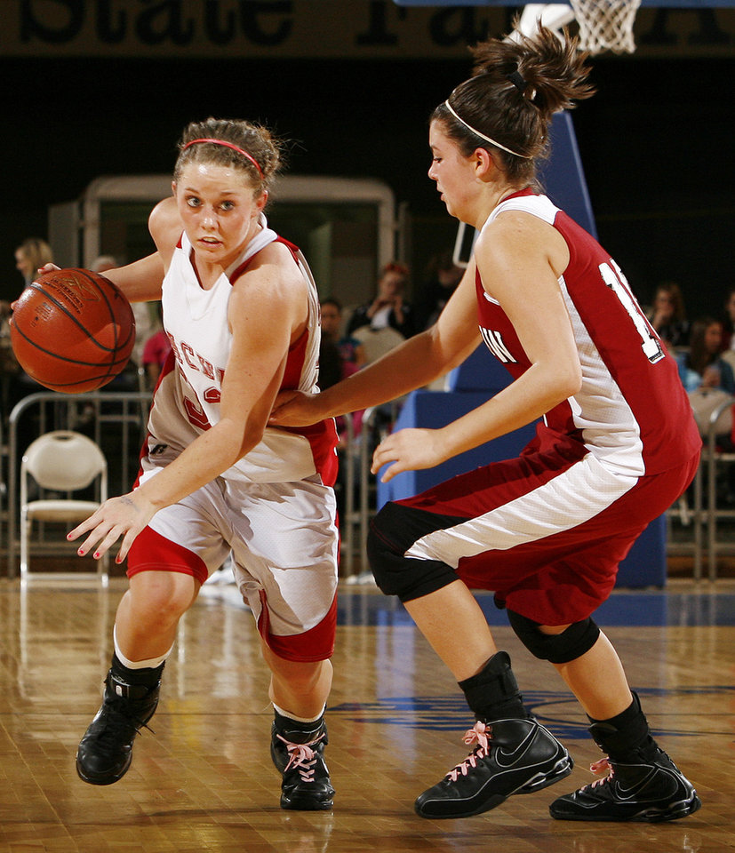 Photo - Cache's Taylor Thompson (33) dribbles past Fallon Tate (10) of Muldrow during 4A girls semifinal game between Muldrow and Cache in the Oklahoma High School Basketball Championships at State Fair Arena in Oklahoma City, Friday, March 13, 2009. Cache won to advance to the championship game. PHOTO BY NATE BILLINGS, THE OKLAHOMAN