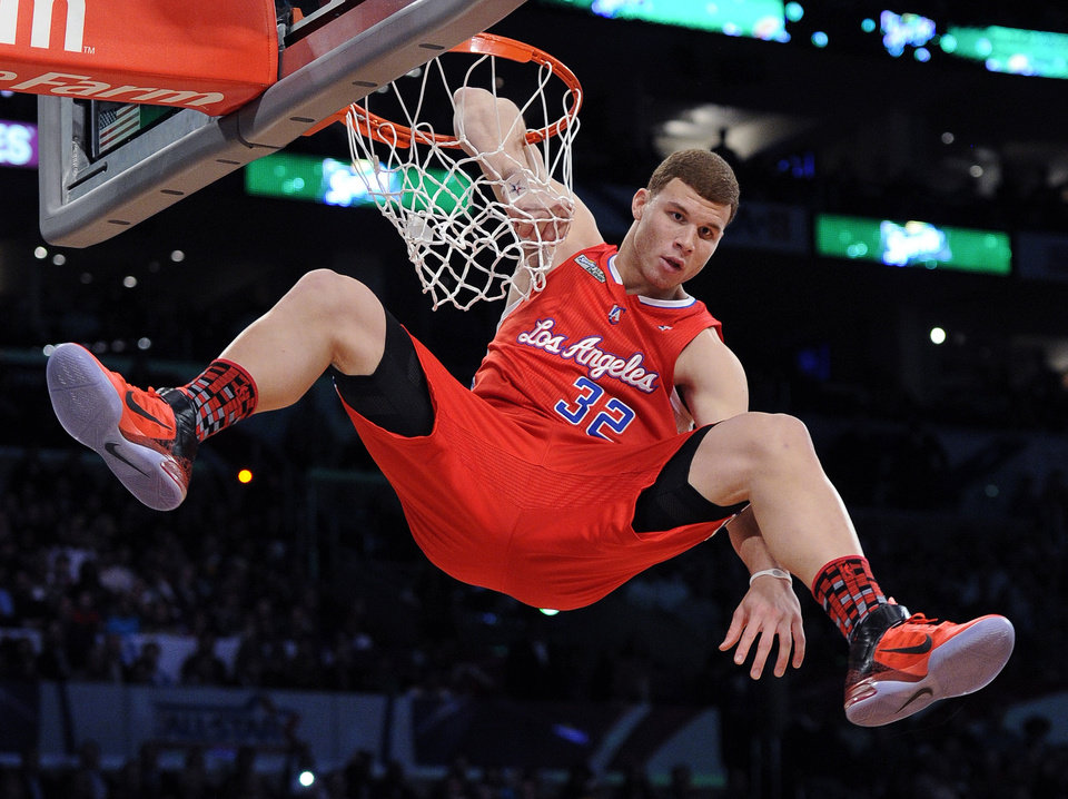 Photo - Los Angeles Clippers' Blake Griffin dunks during the Slam Dunk Contest at the NBA basketball All-Star weekend Saturday, Feb. 19, 2011, in Los Angeles.  (AP Photo/Mark J. Terrill)