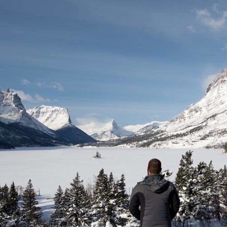 """Photo -  Oklahoma City photographer Bryan Cook looks out over Glacier National Park during one of his hikes for his """"Art 365"""" project, which documents America's National Park and wilderness areas.Photo provided"""