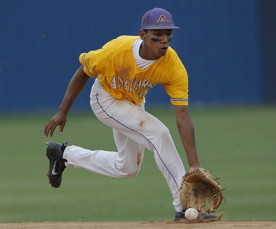 Photo - Anadarko's Kyle Bert tracks down a grounder during the 4A high school baseball playoff game between Hilldale and Anadarko at Shawnee High School in Shawnee, Okla., Friday, May 11, 2012. Photo by Sarah Phipps, The Oklahoman