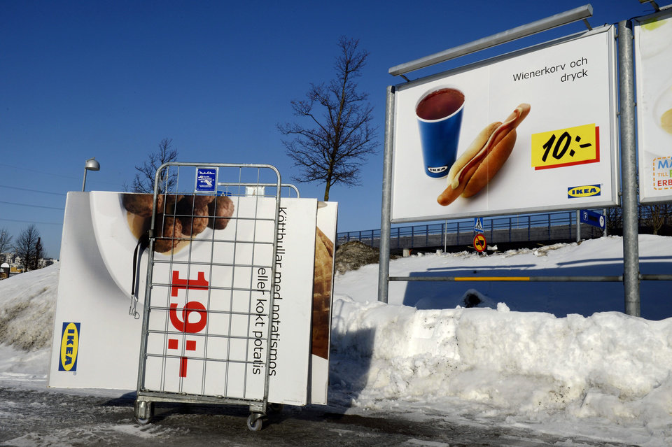Photo - Advertising billboards for Ikea meat balls are taken down from a parking at the Ikea store in Stockholm, Sweden, Monday, Feb. 25, 2012. Swedish furniture giant Ikea was drawn into Europe's widening food labeling scandal Monday as authorities in the Czech Republic said they had detected horse meat in frozen meatballs labeled as beef and pork and sold in 13 countries across the continent. (AP Photo/Jessica Gow) SWEDEN OUT