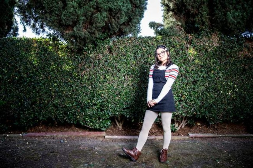 Photo -  Shay Rose poses in the casual look she might wear to virtual classes or her internship. She divides her week between school days and workdays, fitting her crafting and sewing in between. [Mariah Tauger/Los Angeles Times/TNS]