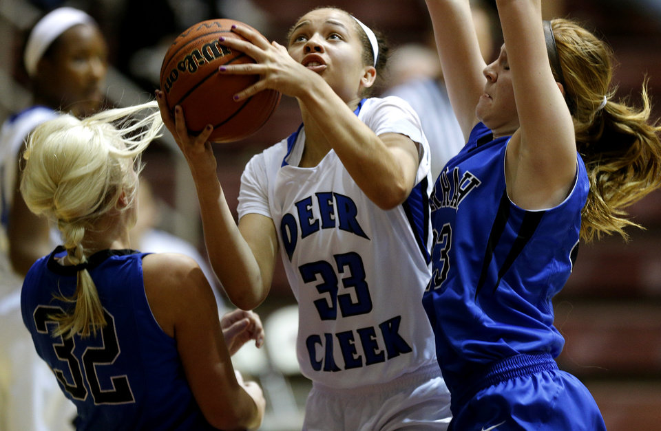 Deer Creek's Ashley Gibson goes to the basket between Harrah's Bailey Mack, left, and Blake Blessington during their girls basketball game in the Bethany Classic tournament at the Sawyer Center in Bethany, Friday, Jan. 11, 2013. Photo by Bryan Terry, The Oklahoman