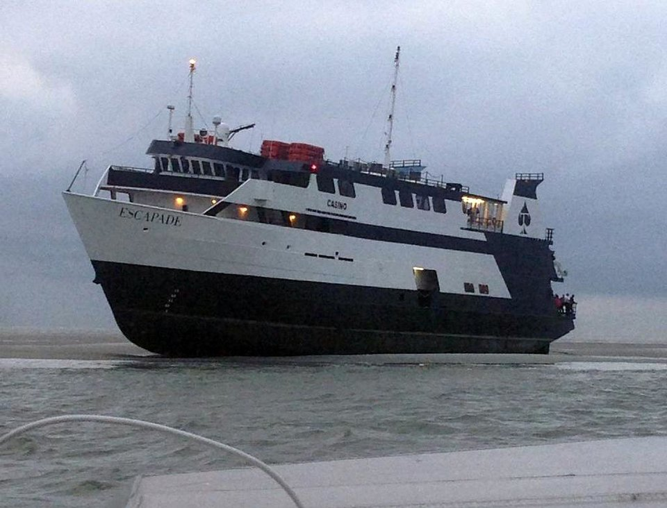 Photo - In this photo provided by the U.S. Coast Guard, the casino boat Escapade, with 123 people aboard, is grounded off the coast of Tybee Island, Ga., Wednesday, July 16, 2014. No injuries or medical issues had been reported among the 96 passengers and 27 crew members aboard the boat according to Coast Guard Petty Officer 3rd Class Anthony L. Soto. (AP Photo/U.S. Coast Guard)