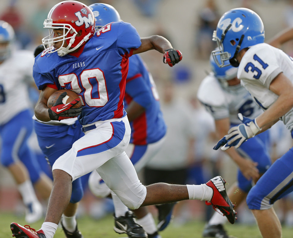 John Marshall's Jabriel Reed runs against Bridge Creek during a high school football game at Taft Stadium in Oklahoma City, Thursday, September 6, 2012. Photo by Bryan Terry, The Oklahoman