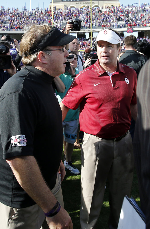 Photo - TCU head coach Gary Patterson, left and Sooner head coach Bob stoops greet after the college football game where the University of Oklahoma Sooners (OU) defeated the Texas Christian University Horned Frogs (TCU) 24-17 at Amon G. Carter Stadium in Fort Worth, Texas, on Saturday, Dec. 1, 2012. Photo by Steve Sisney, The Oklahoman