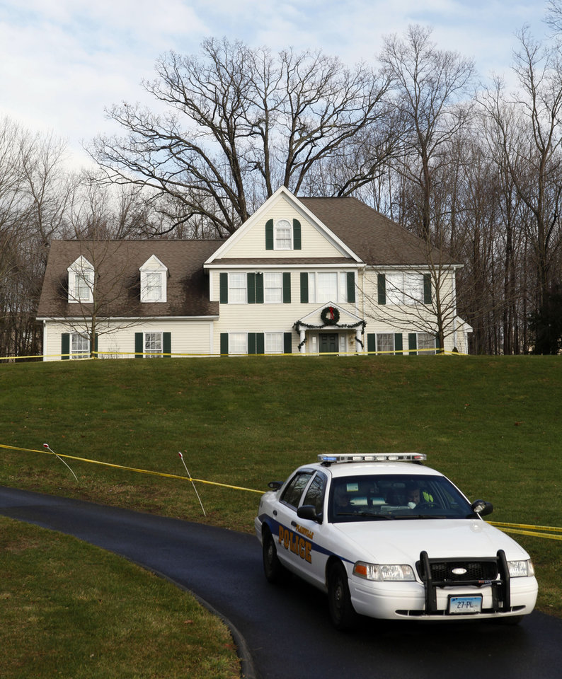 A police cruiser sits in the driveway as crime scene tape surrounds the home of Nancy Lanza, Tuesday, Dec. 18, 2012, in Newtown, Conn.  Nancy Lanza was killed by her son Adam Lanza before he forced his way into Sandy Hook Elementary School in Newtown on Friday and opened fire, killing 26 people, including 20 children. (AP Photo/Jason DeCrow) ORG XMIT: CTJD114