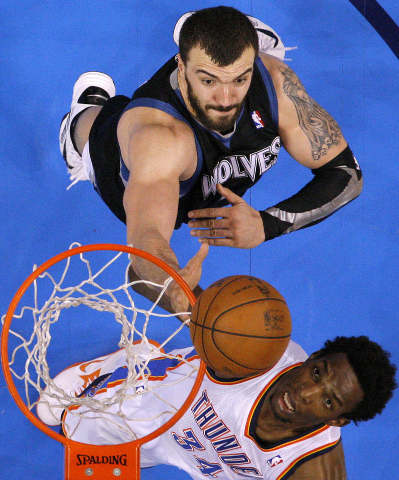 Photo - Oklahoma City's Hasheem Thabeet (34) tries for a rebound beside Minnesota's Nikola Pekovic (14) during an NBA basketball game between the Oklahoma City Thunder and the Minnesota Timberwolves at Chesapeake Energy Arena in Oklahoma City, Wednesday, Jan. 9, 2013.  Oklahoma City won 106-84. Photo by Bryan Terry, The Oklahoman