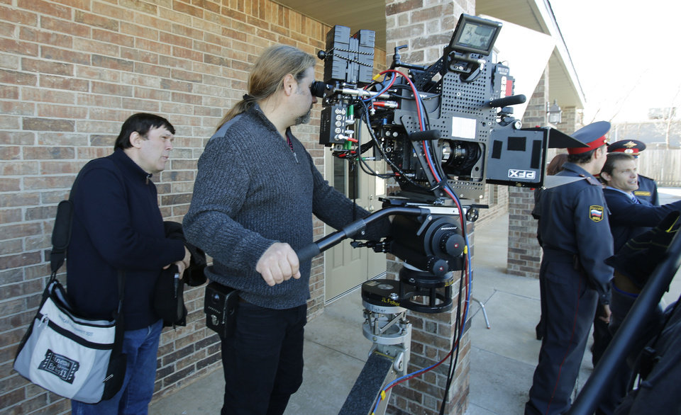 "Russian writer-director Vladimir Uglichin, left, and his cinematographer Andrea V. Rossotto set up a shot with a 3-D camera during the filming of ""Higher Mission"" a sci-fi movie being shot in Oklahoma City. Photo By Steve Gooch, The Oklahoman <strong>Steve Gooch</strong>"