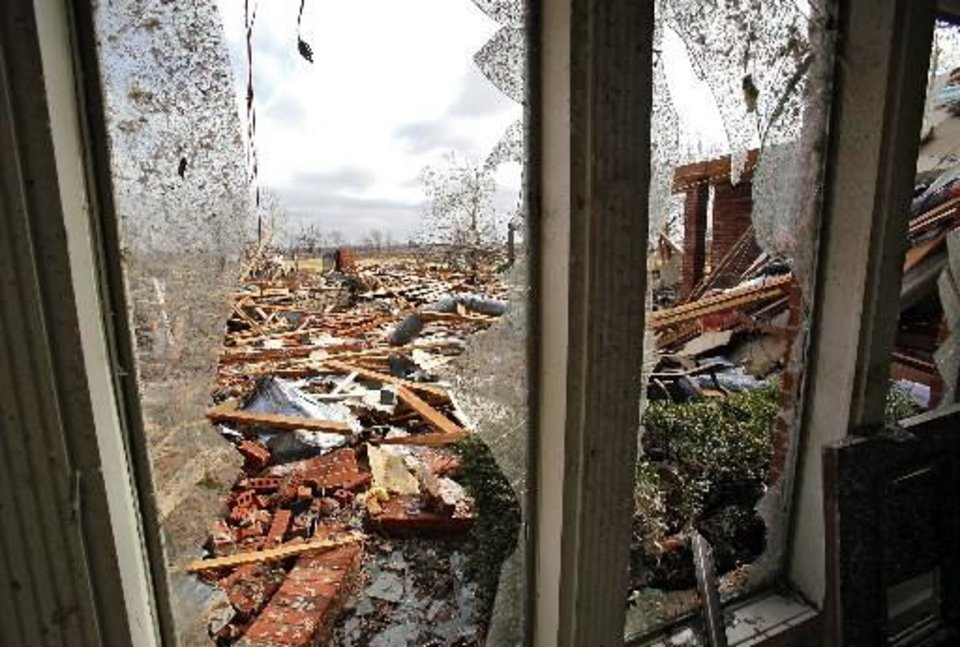 Damage to a home in the Oak Tree housing addition on Wednesday, Feb. 11, 2009, after a  tornado hit the area on Tuesday in  Edmond, Okla. PHOTO BY CHRIS LANDSBERGER