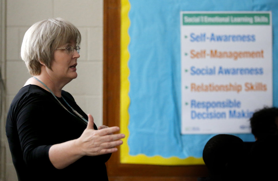 Photo -  Kathy Harm leads a discussion during a Teen emPower session at Taft Middle School in Oklahoma City in May. [Photo by Sarah Phipps, The Oklahoman]