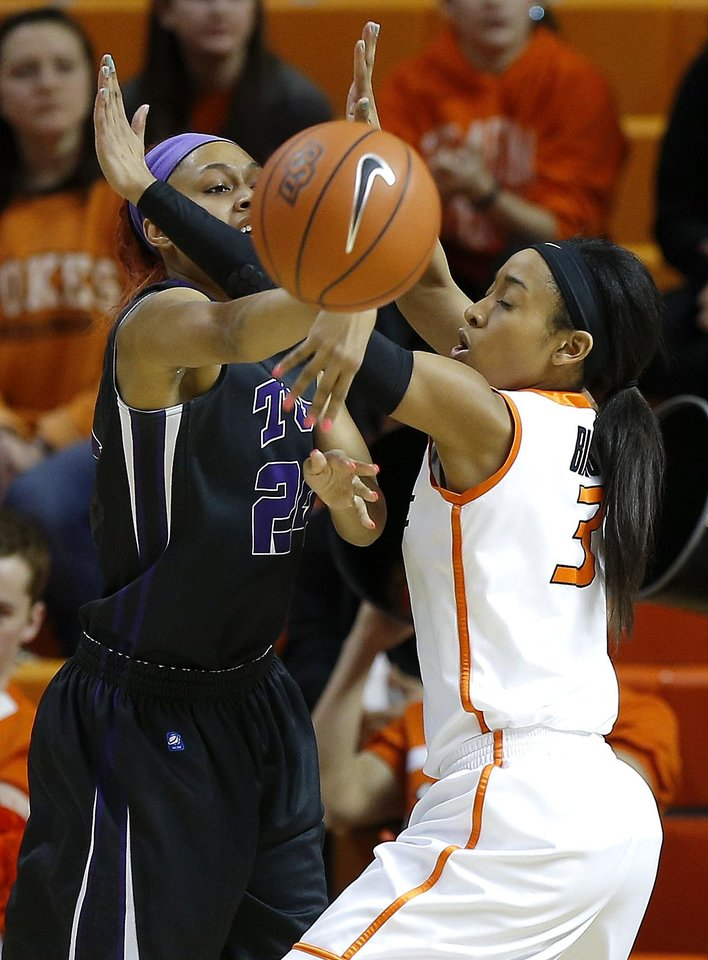 TCU's Natalie Ventress (24) passes the ball past Oklahoma State's Tiffany Bias (3) during a women's NCAA college basketball game between Oklahoma State University (OSU) and TCU at Gallagher-Iba Arena in Stillwater, Okla., Tuesday, Jan. 14, 2014.  Photo by Bryan Terry, The Oklahoman