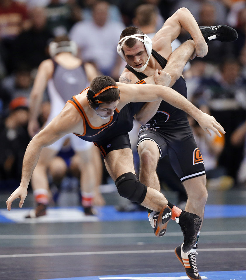 Photo - Oklahoma State's Joshua Kindig takes down Oregon State's Scott Sakaguchi in the 149 pound match during the 2014 NCAA Div. 1 Wrestling Championships at Chesapeake Energy Arena in Oklahoma City, Okla. on Friday, March 21, 2014. Photo by Chris Landsberger, The Oklahoman