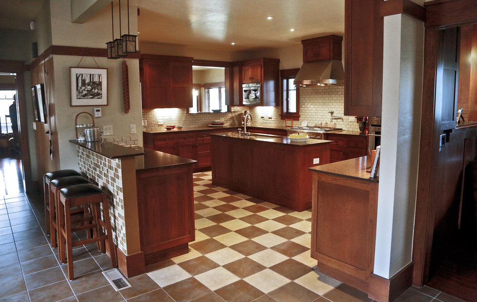 Photo - The Woffords' kitchen is equipped with modern appliances, but its chessboard tile floor is the type that might have been laid by Frank Llloyd Wright himself.  CHRIS LANDSBERGER - The Oklahoman