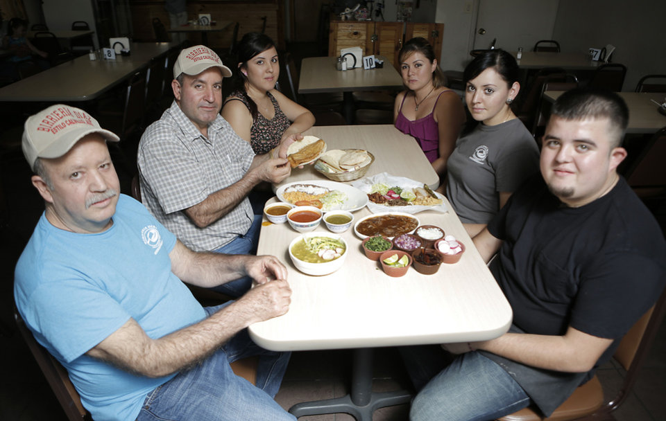 From left: Ruben Diaz, Juan M Diaz, Lorena Diaz, Veronica Flores, Fabiola Lopez, and Juan Carlos Diaz, pose for a photo at Birrieria Diaz in Bethany. <strong>Garett Fisbeck - Garett Fisbeck</strong>