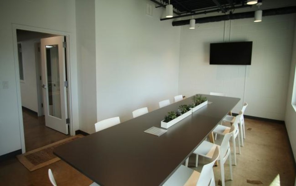 Photo -  An upstairs conference room is seen at Workflow OKC. [Doug Hoke/The Oklahoman]