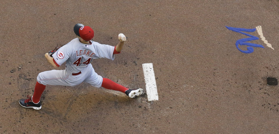 Photo - Cincinnati Reds starting pitcher Mike Leake throws during the first inning of a baseball game against the Milwaukee Brewers Wednesday, July 23, 2014, in Milwaukee. (AP Photo/Morry Gash)