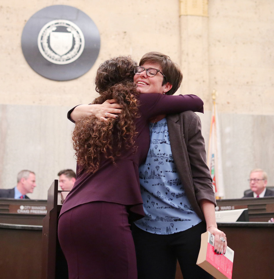 Photo - Carrie Blumert, Dist. 1 County Commissioner, hugs JoBeth Hamon, ward 6, during the swearing in ceremony for the Oklahoma City Council, Tuesday, April 9, 2019.  Photo by Doug Hoke/The Oklahoman