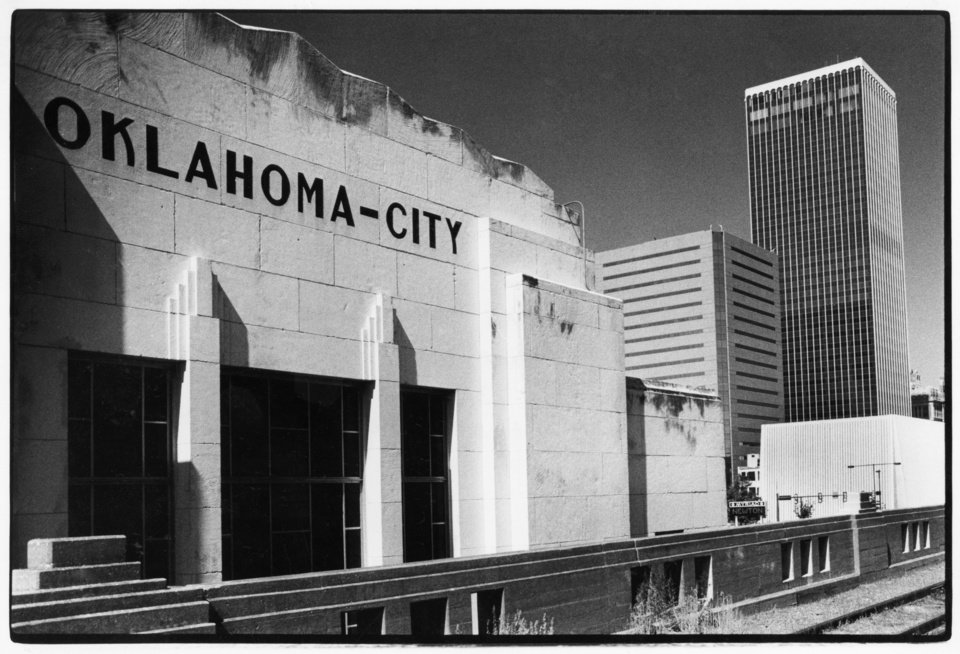 OKLAHOMA CITY / SKY LINE / OKLAHOMA: ...even though thousands of people drive by it every day. This unconventional view of downtown Oklahoma City was shot from the upper track level of the old Santa Fe train depot near the Myriad and next to E. K. Gaylord Boulevard, a main commuter thoroughfare. (Liberty & Mid-America Tower in background) Staff photo by Jim Beckel. Photo dated 12/29/1985 and published on 01/08/1986 in The Daily Oklahoman (N).