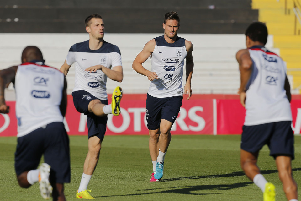 Photo - France's forward Olivier Giroud, second right, run on the pitch during a training session at the Santa Cruz Stadium in Ribeirao Preto, Brazil, Monday, June 16, 2014. France plays in group E of the 2014 Brazil soccer World Cup. (AP Photo/David Vincent)