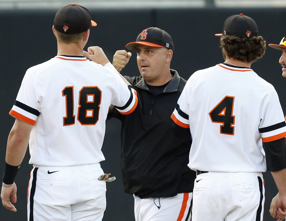 Photo - OSU coach Josh Holliday greets his players, including Hunter Hagler (18) and Brendan McCurry (4), before Game 1 of the NCAA baseball Stillwater Super Regional between Oklahoma State and UC-Irvine at Allie P. Reynolds Stadium in Stillwater, Okla., Friday, June 6, 2014. Photo by Nate Billings, The Oklahoman