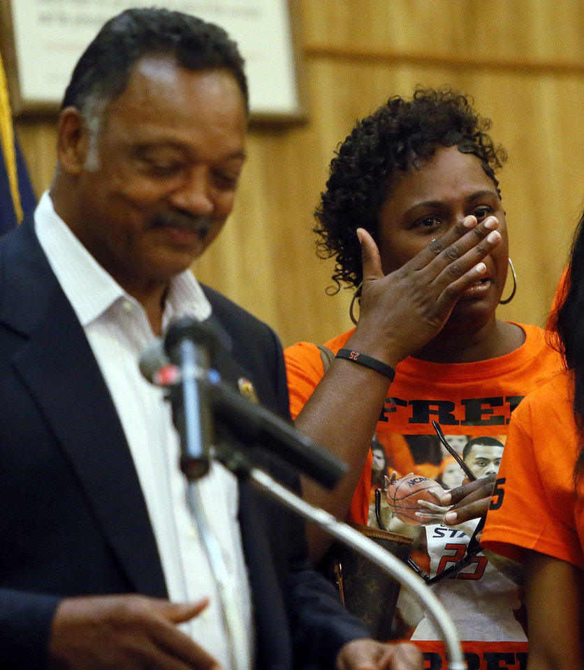 Photo - Mildred Williams, aunt of Darrell Williams, wipes tears from her face as Rev. Jesse Jackson speaks during a rally in support of Darrell Williams at Mt. Zion Baptist Church in Stillwater, Okla., Thursday, Aug. 23, 2012. Williams, a suspended Oklahoma State basketball player, was found guilty on two counts of rape by instrumentation and one count of sexual battery after an incident at a house party. Photo by Nate Billings, The Oklahoman