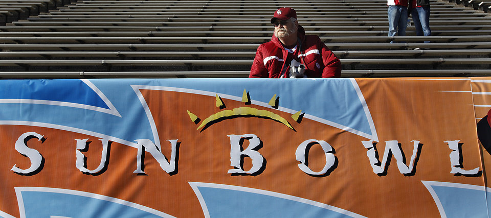 Photo - Sooner fan John Good, of California, sits in the stands before the Brut Sun Bowl college football game between the University of Oklahoma Sooners (OU) and the Stanford University Cardinal on Thursday, Dec. 31, 2009, in El Paso, Tex.   Photo by Chris Landsberger, The Oklahoman