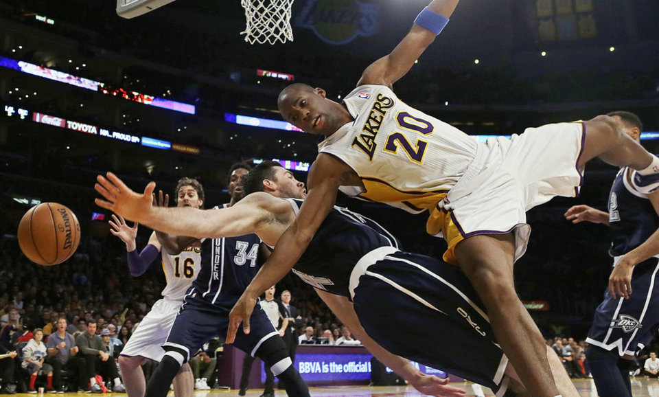 Photo - Los Angeles Lakers guard Jodie Meeks (20) is fouled by Oklahoma City Thunder forward Nick Collison (4) in the first half of an NBA basketball game in Los Angeles, Sunday, Jan. 27, 2013. The Lakers won 105-96. (AP Photo/Reed Saxon) ORG XMIT: LAS105