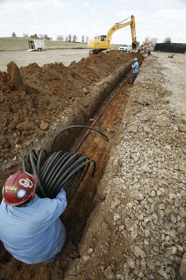 In a 2012 file photo, workers prepare a Osage Exploration disposal well near Crescent. PAUL HELLSTERN - The Oklahoman