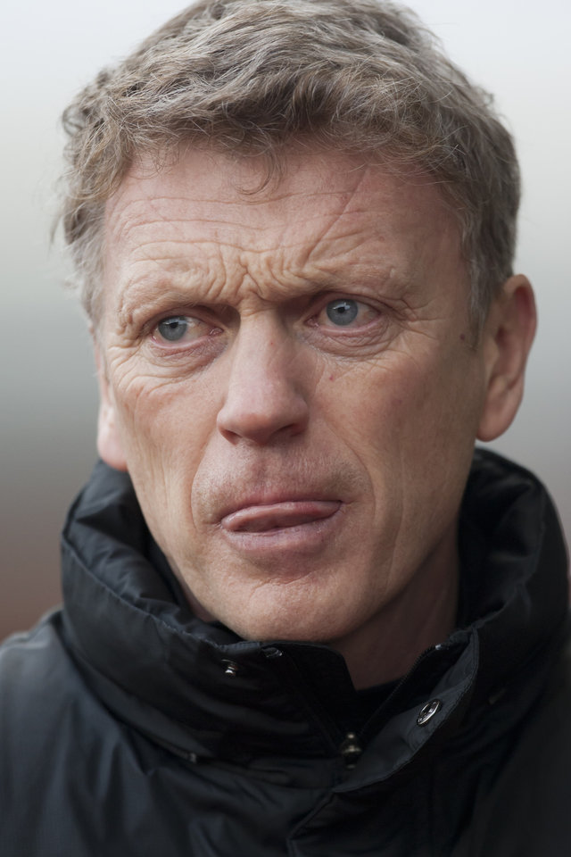 Photo - Manchester United's manager David Moyes takes to the touchline before his team's 2-1 loss at Stoke in their English Premier League soccer match at the Britannia Stadium, Stoke, England, Saturday Feb. 1, 2014. (AP Photo/Jon Super)