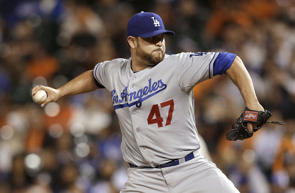 Photo - Los Angeles Dodgers pitcher Ricky Nolasco throws to a San Francisco Giants batter during the first inning of a baseball game in San Francisco, Wednesday, Sept. 25, 2013. (AP Photo/Jeff Chiu)